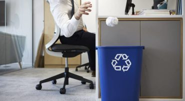 worker with paper recycling