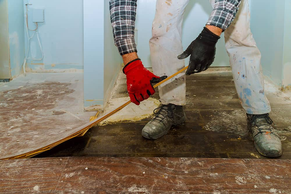 ripping up flooring and disposing